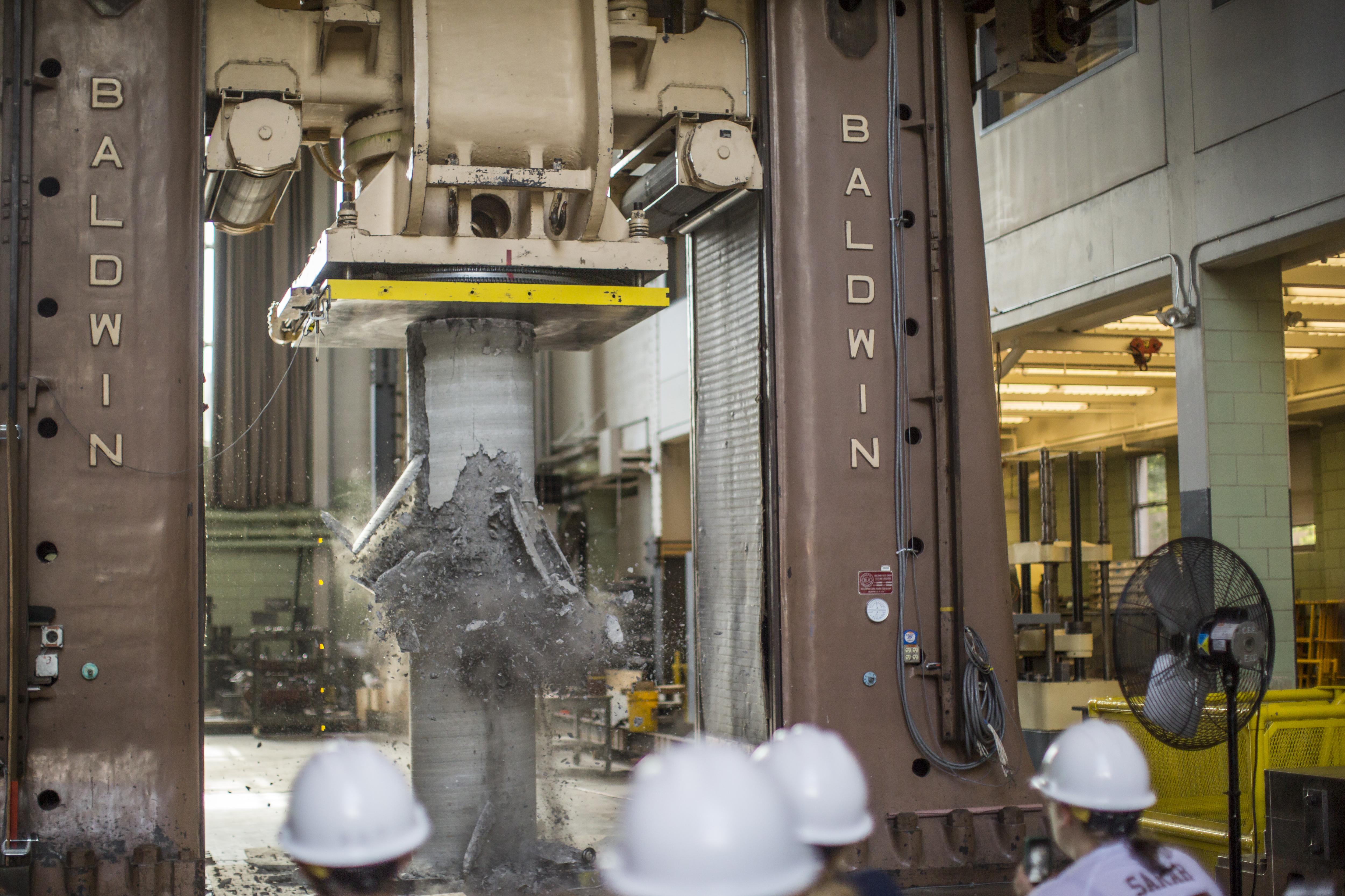 testing machine in fritz lab testing a pillar for breakage. shattered pillar