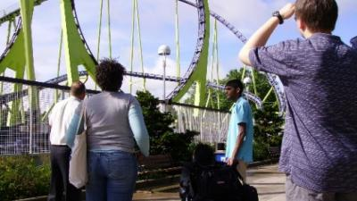 REU students look at a roller coaster
